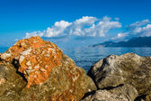 Rocks, sea and blue sky with clouds — Foto Stock
