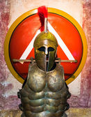 Spartan helmet, armor and shield — Stock Photo