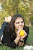 Girl with orange — Stock Photo