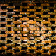 Repeating brick pattern with spaces and a solid brick wall through the gaps - Stock Photo