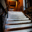 Concrete Stairs in brick stairwell — Stock Photo #25141893