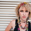 Blond girl with bright beads — Photo