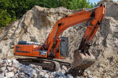 Excavator at a construction site. — Stock Photo