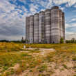 Abandoned silos at the port — Stock Photo