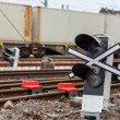 Railway signaling and a passing train — Stock Photo