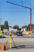 Theodolite on a tripod at the construction site — Stock Photo