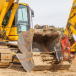 Construction site - excavator with removable bucket — Stock Photo