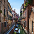 Narrow canal and boats - Venice, Italy — Stock Photo #33610489