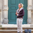Businesswoman standing on a historic street — Stock Photo