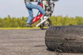 Motorcycle Tricks on unused runway — Stock Photo
