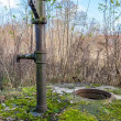 The old hand pump on the well — Stock Photo