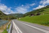 Asphalt road in the Alps - Austria — Stock Photo