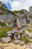 Mountain stream forms a waterfall — Stock Photo