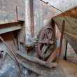 The gear wheel of a rusty old machine in brick factory — Stock Photo