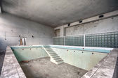 Swimming pool in a ruined building — Stock Photo