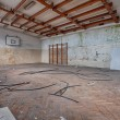Abandoned sports hall in a devastated building — Stock Photo #43489231