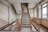 Staircase in an abandoned and forgotten building — Stock Photo