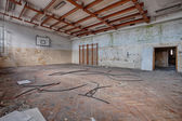 Abandoned sports hall in a devastated building — Stock Photo