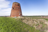 The brick tower destroyed of a windmill — Stockfoto