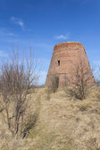 The brick tower destroyed of a windmill — Stok fotoğraf