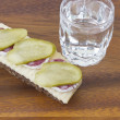 Glass of Russian vodka with snack — Stock Photo