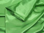 Green silk background — Stock Photo