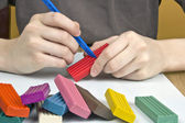 Boy moulds from plasticine — Stock Photo
