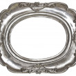 Oval silver picture frame with a decorative pattern — Stock Photo #27504753
