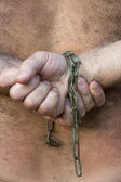 Man's hands tied with chains — Stock Photo