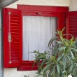 Old window with red shutter — Stock Photo #33142079