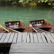 Wooden boats on water — Stock Photo