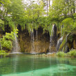 Summer view of beautiful small waterfalls in Plitvice Lakes National Park, Croatia — Stock Photo