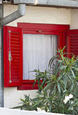 Old window with red shutter — Stock Photo