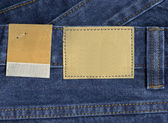 Blank leather and paper jeans labels — Stockfoto