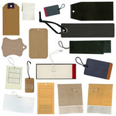 Set of various grungy aged paper tags — Stock Photo