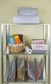 Metal shelves with different home related objects — Foto Stock