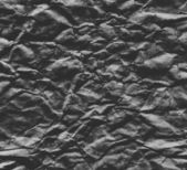 Sheet of black crumpled paper — Stock Photo