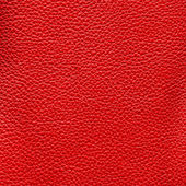 Red leather texture as background — Stock Photo
