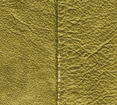 Worn yellow leather texture, stitch. — Stock Photo