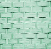 Green straw background, basket weave, texture. — Stock Photo