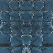 Reptile skin, blue leather background  — Stock Photo