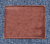 Blank reddish leather label — Stock Photo