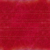 Red worn leather texture, seams — Stok fotoğraf