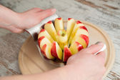 A knife in a red  apple — Stock Photo
