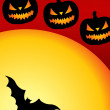 Halloween pumpkin and bats flying — Stock Photo