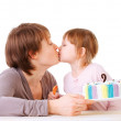 Little daughter kissing her mother. — Stock Photo
