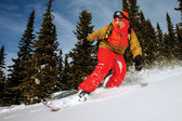 Snowboarder doing a toe side carve. — Stock Photo