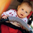 Baby in sitting stroller — Stock Photo #38891371