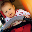 Baby in sitting stroller — Stock Photo #38979861
