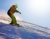 Snowboarder doing a toe side carve — Stock Photo